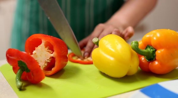 Fresh peppers being sliced in cookery class