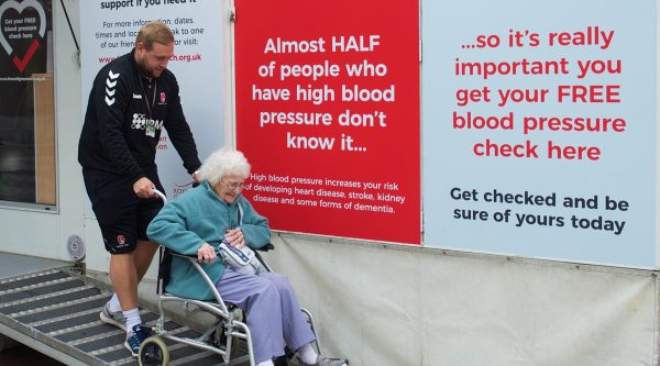 Elderly lady visiting blood pressure roadshow