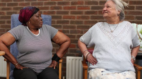 Two ladies talking to each other about dementia