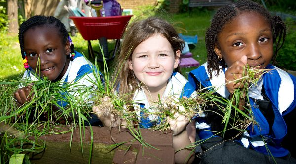 School children in garden. Healthy Schools.